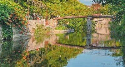 Bridge over reflective water
